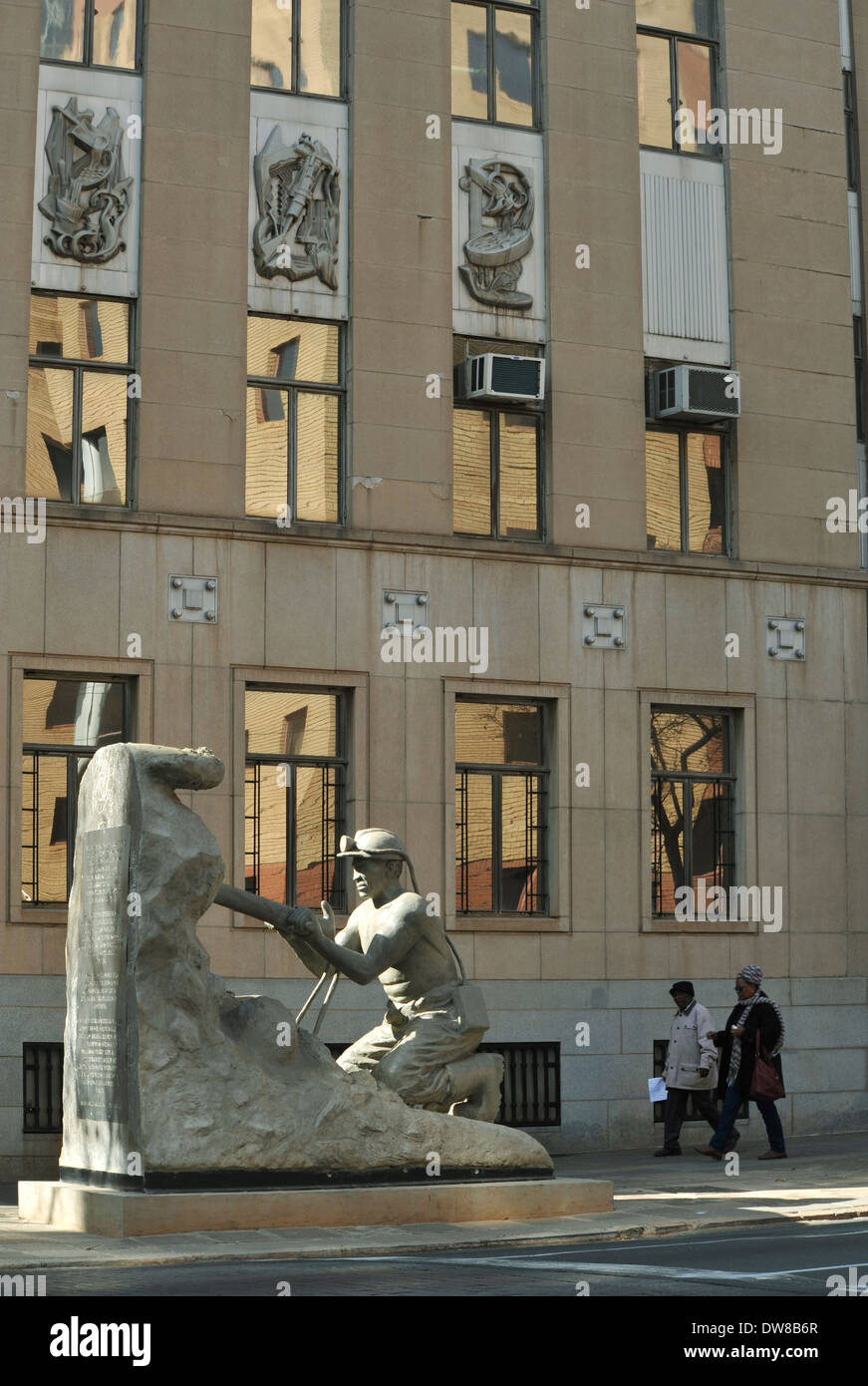 Johannesburg, Gauteng, South Africa, people walking past sculpture of mine worker drilling, statue honouring role of miners, downtown, city - Stock Image