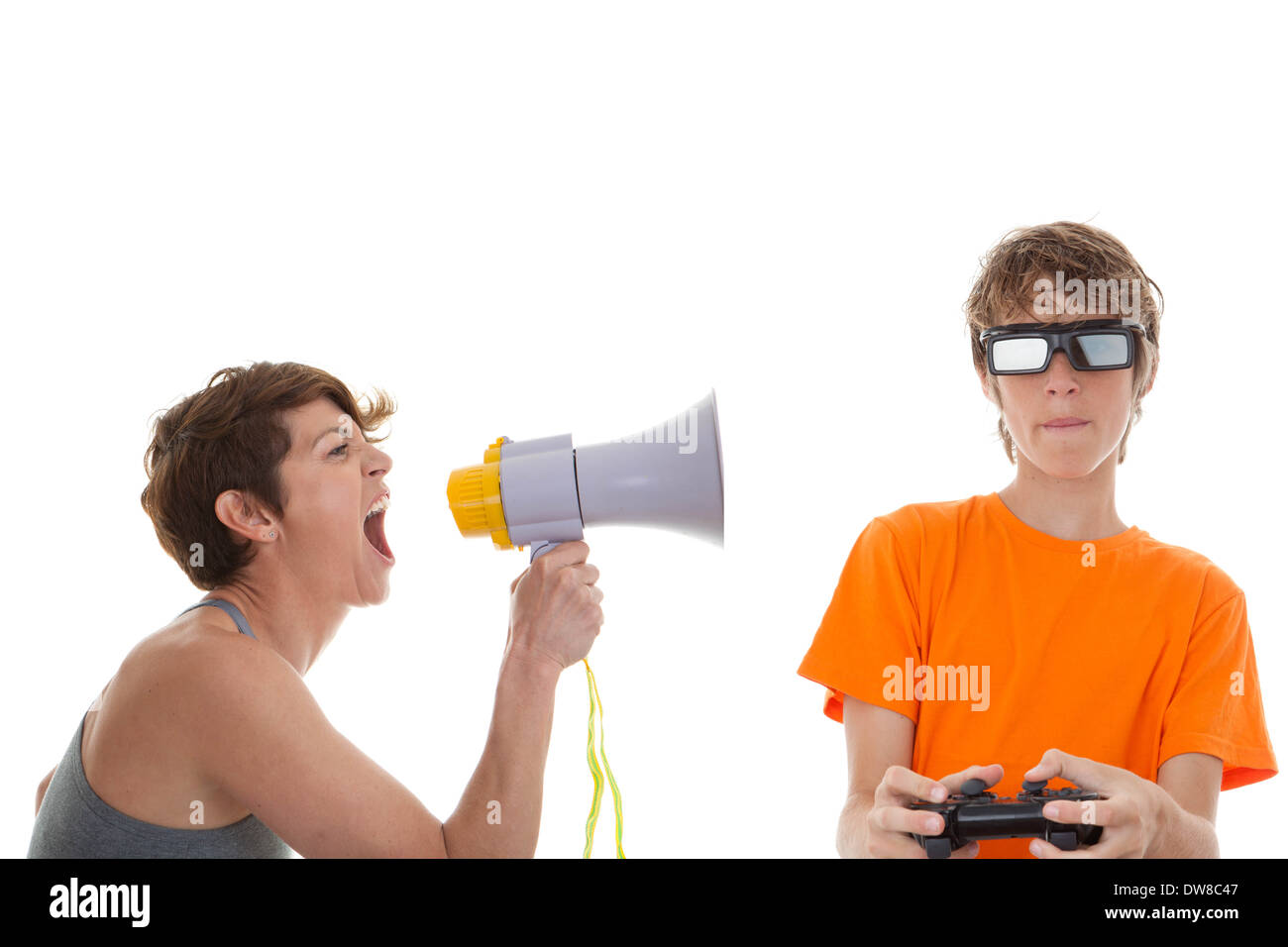 angry mother of teen playing computer games - Stock Image