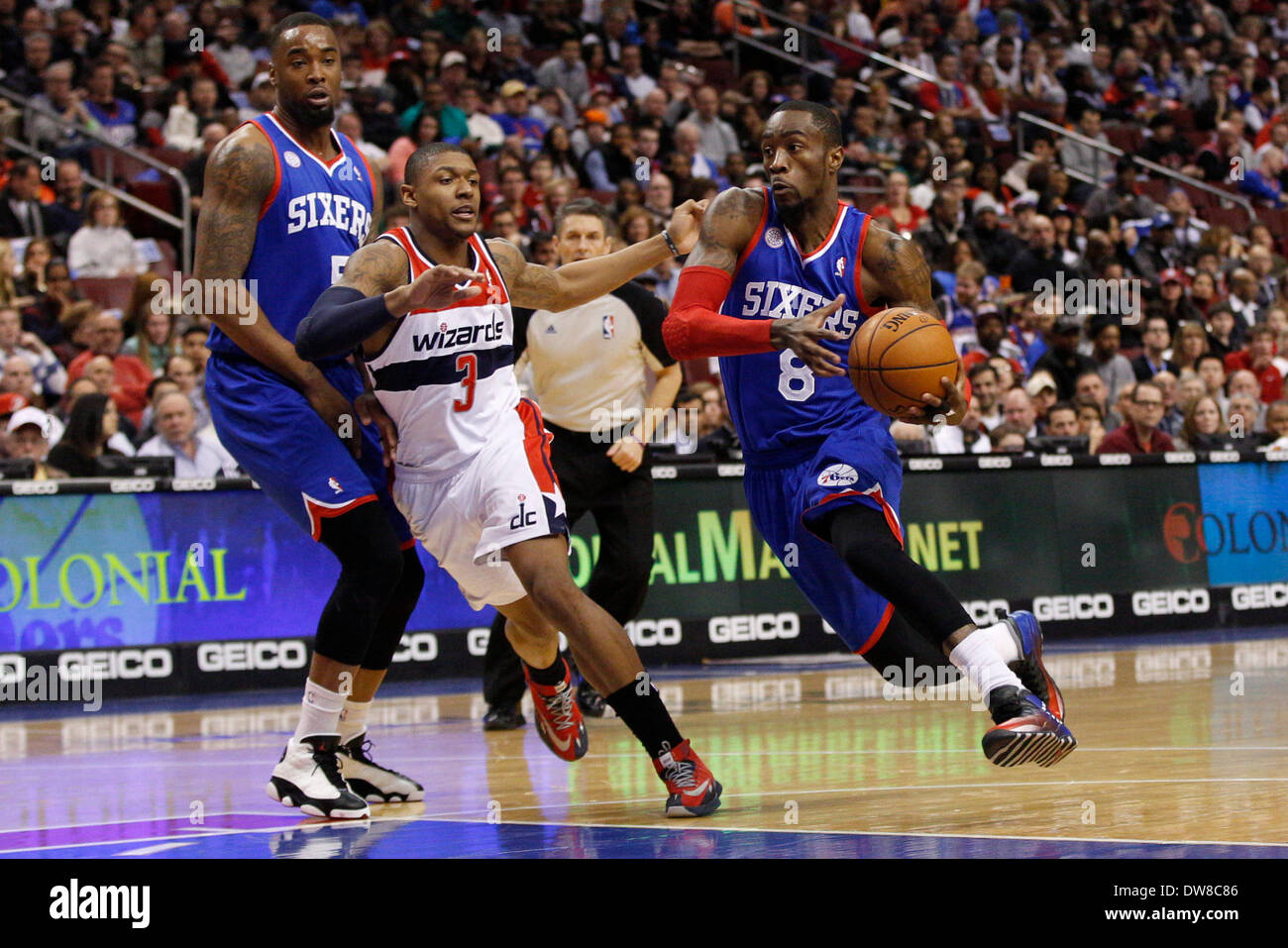 4b9430cbf ... Tony Wroten (8) drives to the basket as power forward Arnett Moultrie  (5) tried to set the screen on Washington Wizards shooting guard Bradley  Beal ...