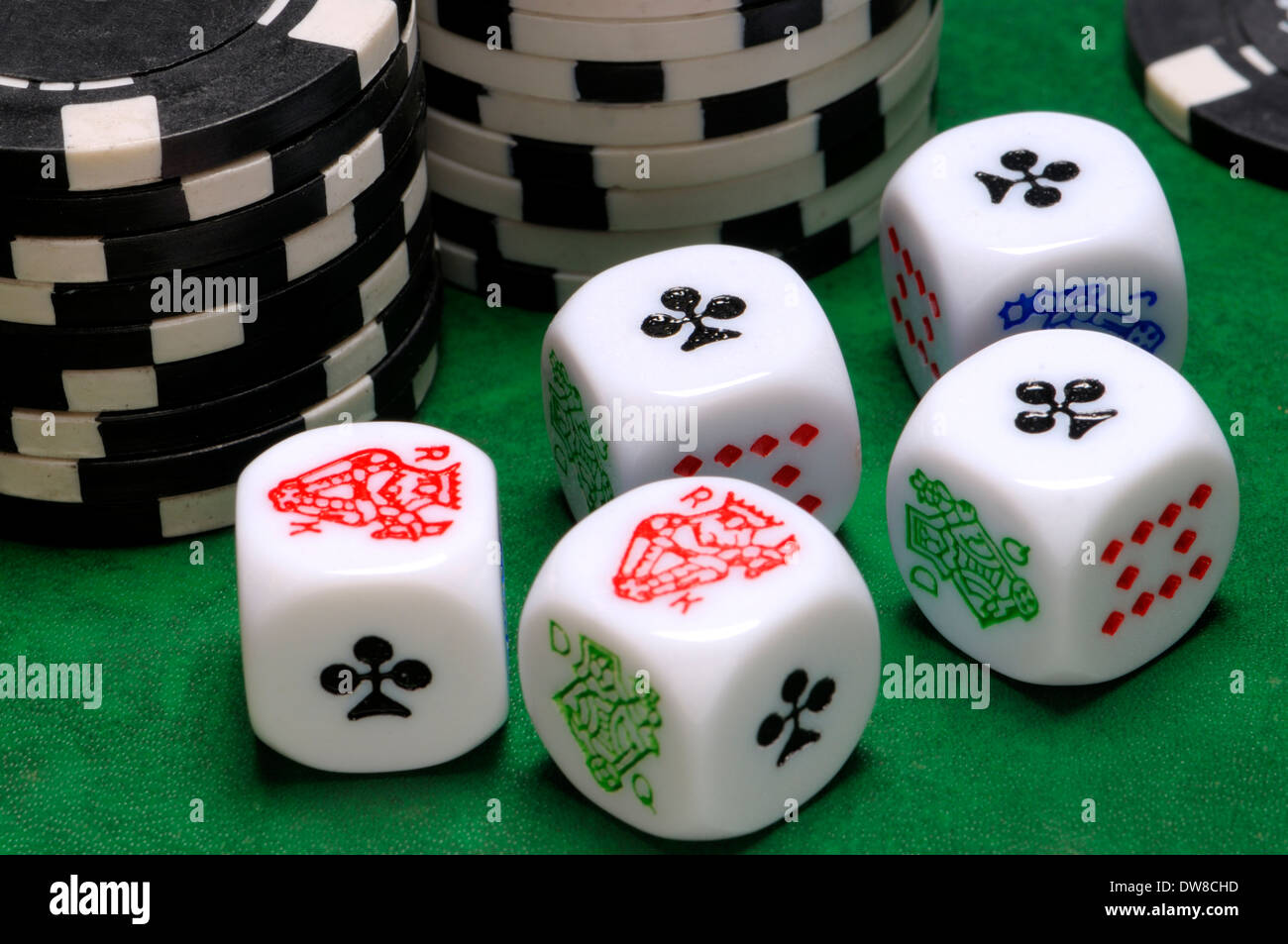 Poker dice and betting chips - Stock Image
