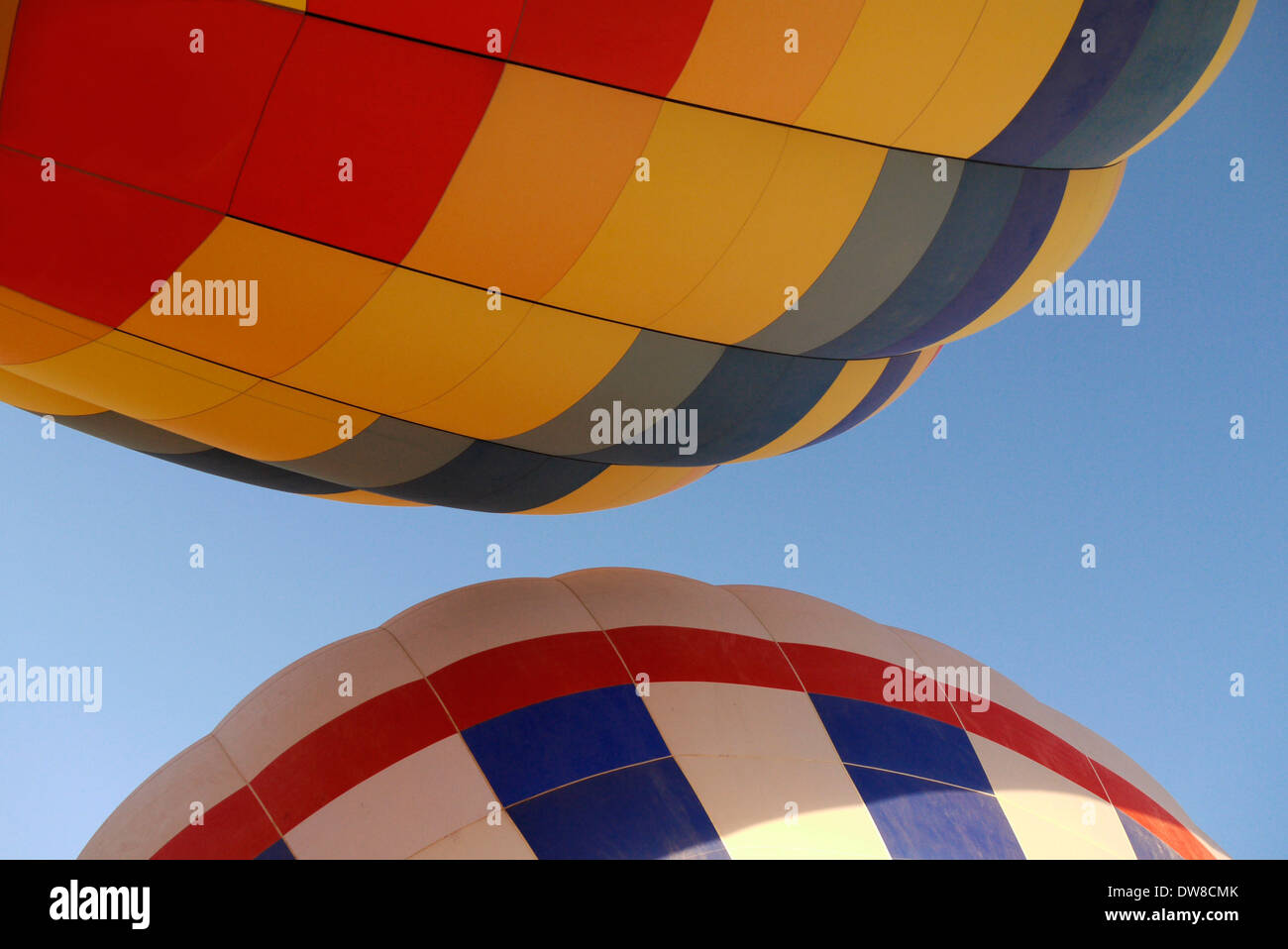 Two hot air balloons, as they are launched in Albuquerque New Mexico - Stock Image