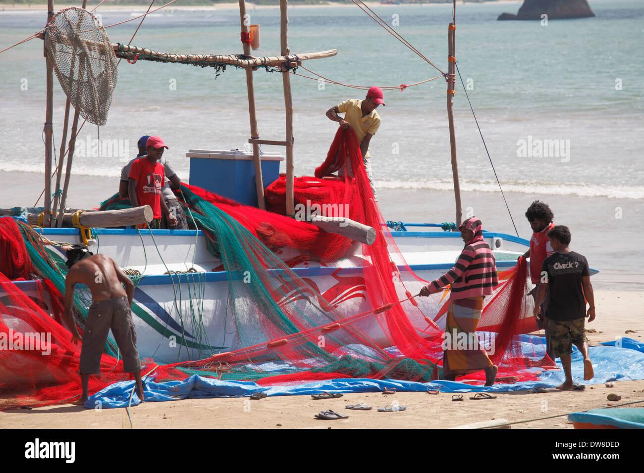 Sri Lanka, Weligama, fishermen plying their nets, - Stock Image