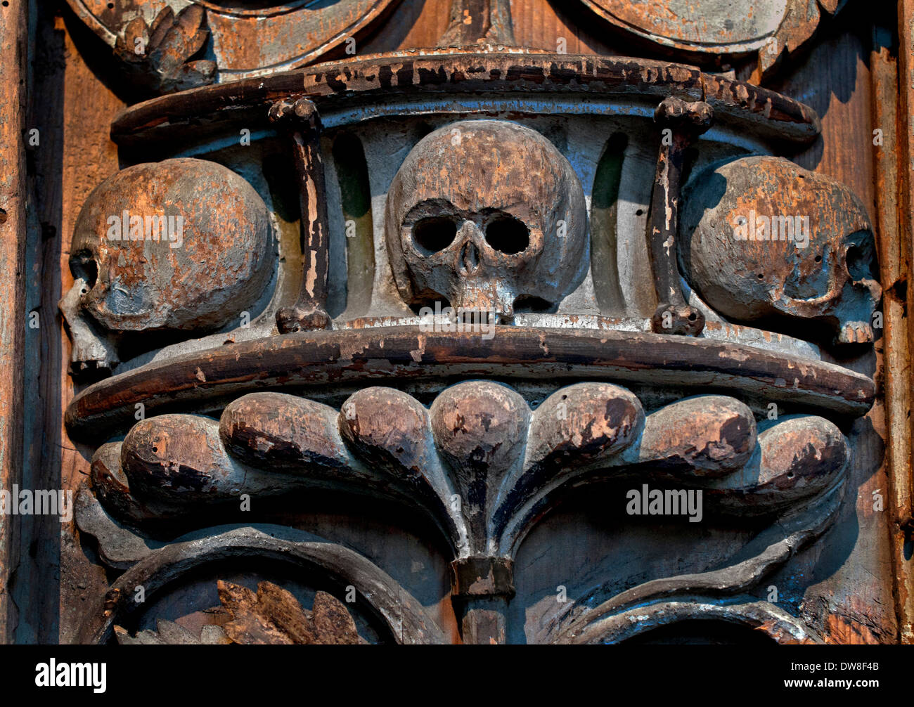Fragment from a Epitaph (skeleton skull ) 16 Century wood Church de Soest Westphalia German Germany - Stock Image