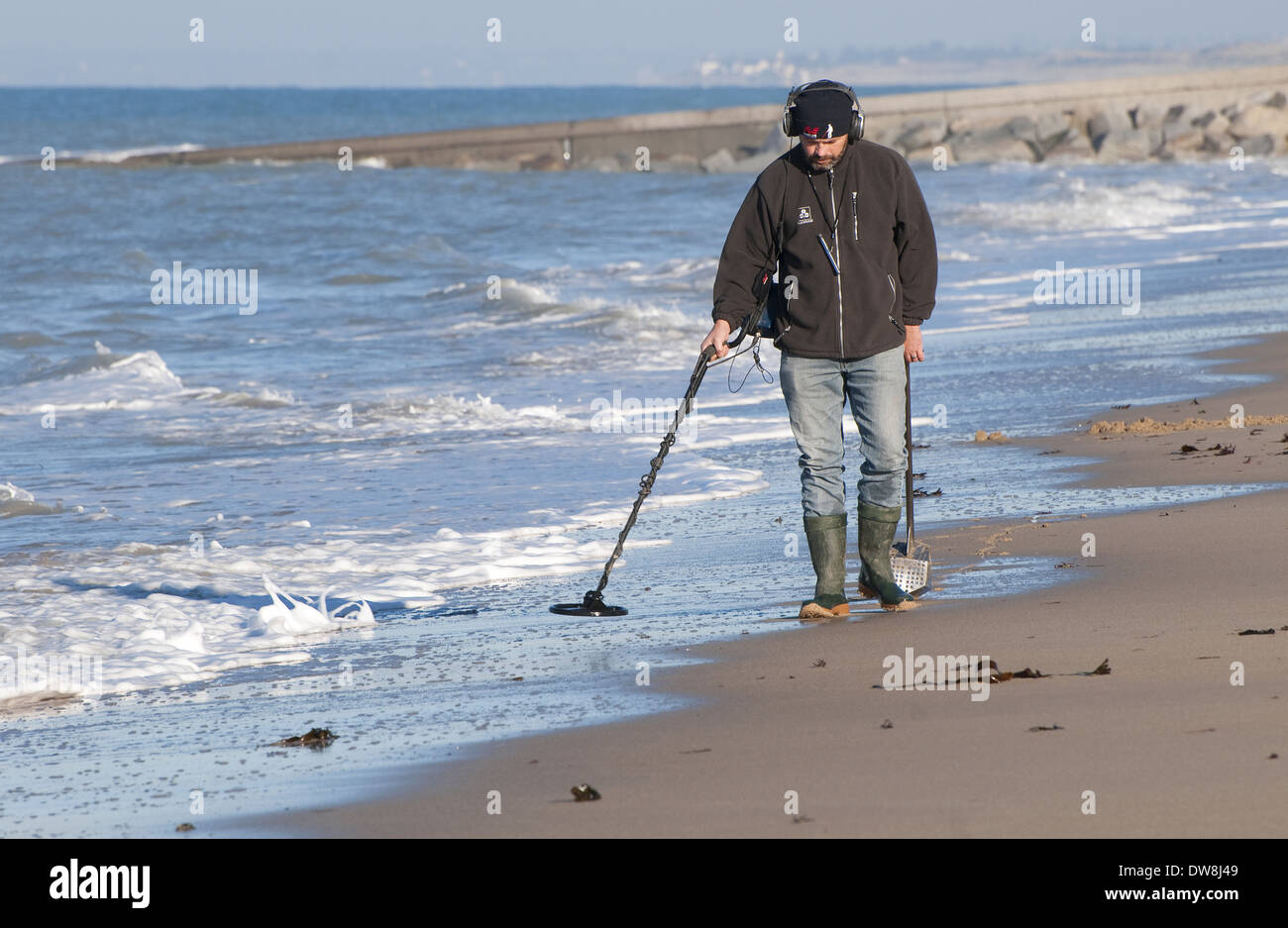 Jew Detector: Man Using Metal Detector On Beach Near Granville Manche