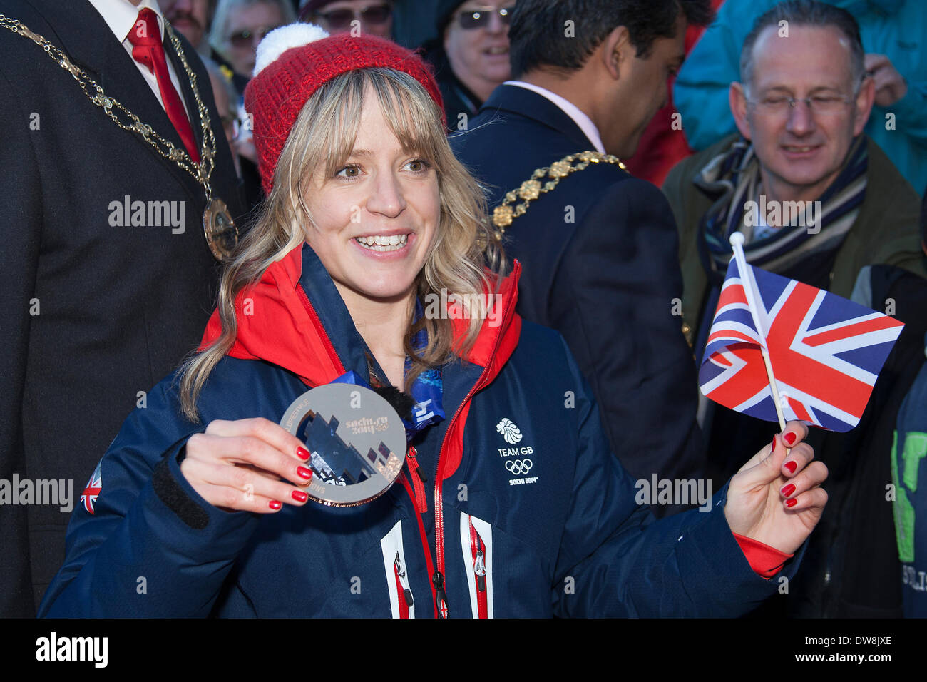 Bristol, UK. 3rd Mar, 2014. Snowboarder Jenny Jones toured through the streets of Bristol on an open top bus to celebrate her bronze medal win at the Sochi winter Olympics.  The bus went from her home area of Downend in South Gloucestershire to the Council Offices in Bristol city centre.  Afterwards she attended a reception in the council offices.  Supporters turned out along the route waving Union Jack flags in Bristol, March 3rd 2014. Credit:  Redorbital Photography/Alamy Live News - Stock Image