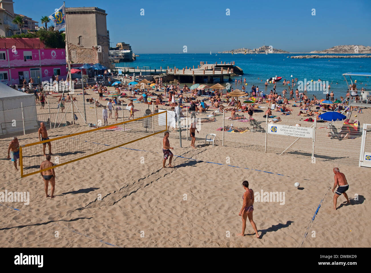 People Playing Beach Volleyball, Plage des Catalans, Marseille, France - Stock Image