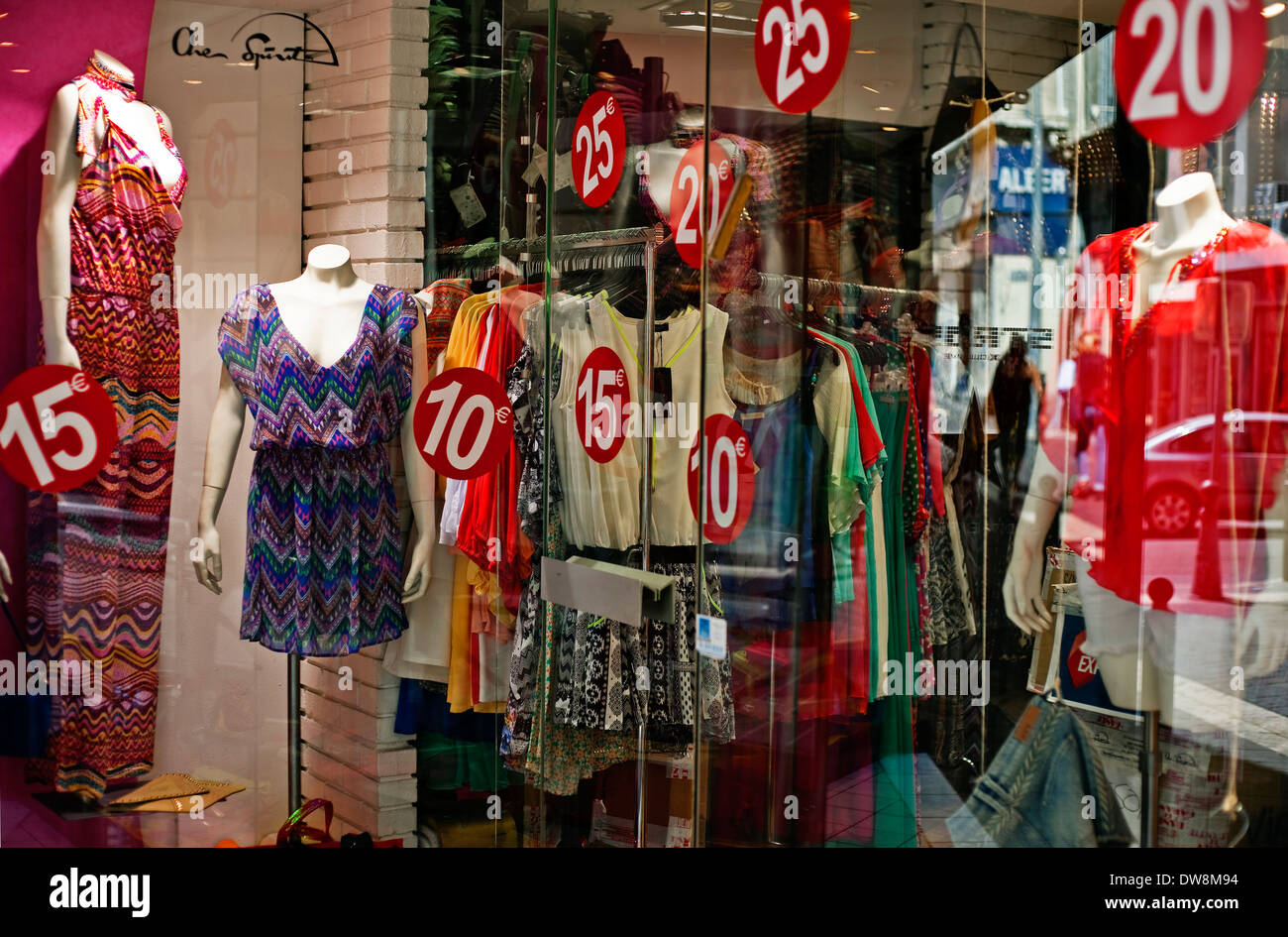15,10, 20, 25 euro price discs in red on womens clothing shop window Marseilles France Stock Photo