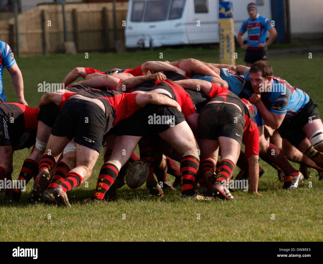 Scrum during amateur rugby match, Bude, Cornwall, UK - Stock Image