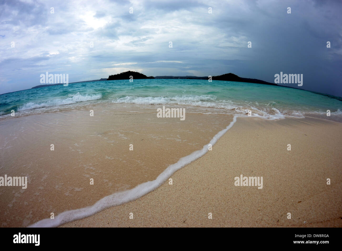 Storm approaches Nukuifala Islet, viewed from Nukuione Islet, Uvea, Wallis & Futuna, South Pacific - Stock Image