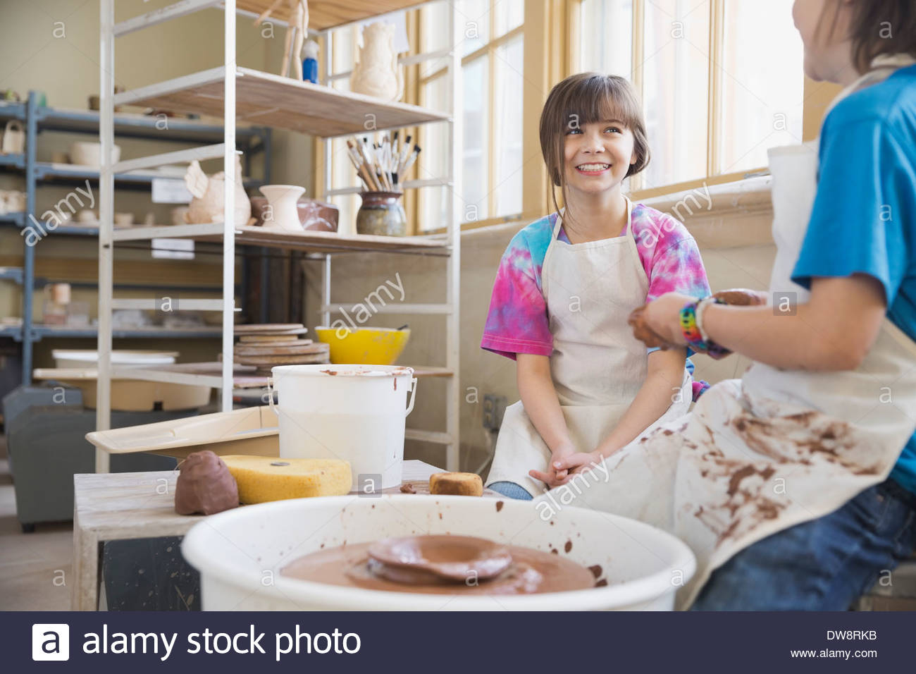 Friends in pottery class - Stock Image