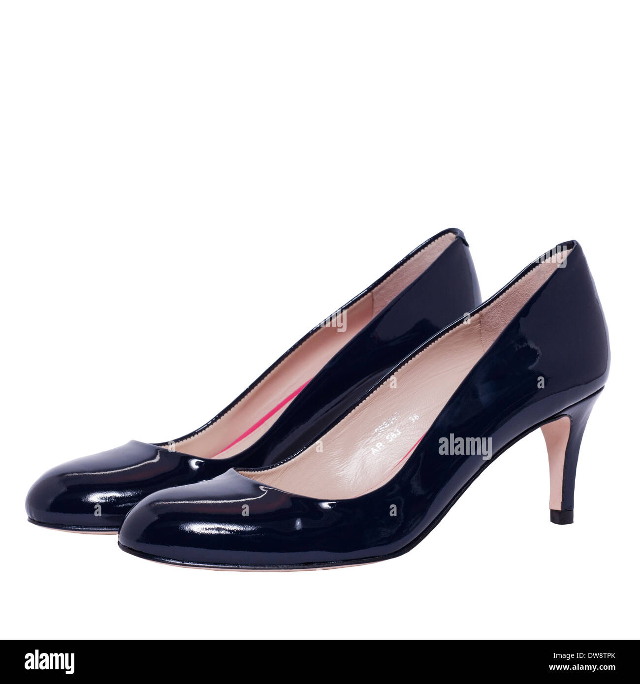 A pair of womens blue patent court shoes on a white background - Stock Image