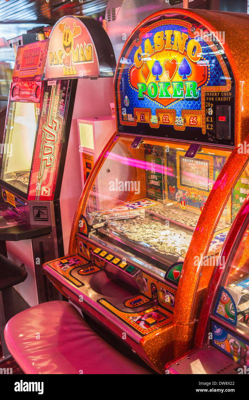 Brightly coloured red slot machine in amusement arcade in Sandown Pier, Isle of Wight, UK - Stock Image
