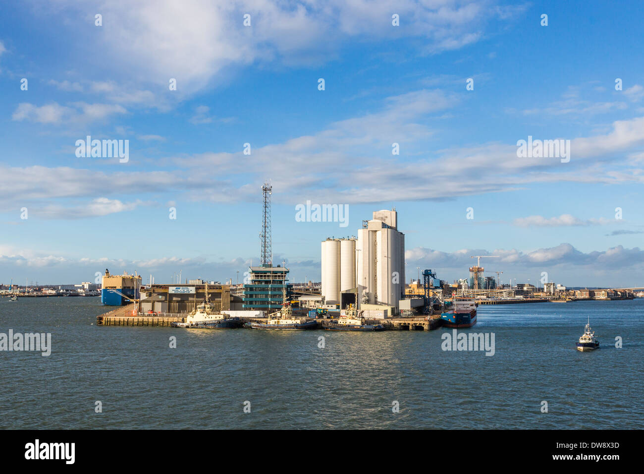 View of Southampton Docks on the Solent, Hampshire, UK with blue sky and clouds on a sunny day - Stock Image