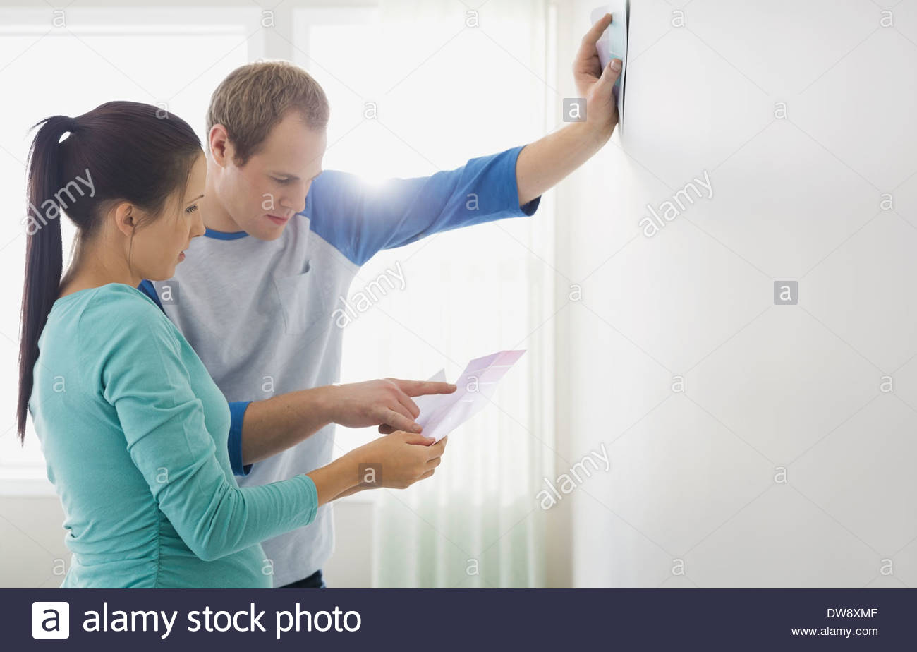 Couple looking at color swatches - Stock Image