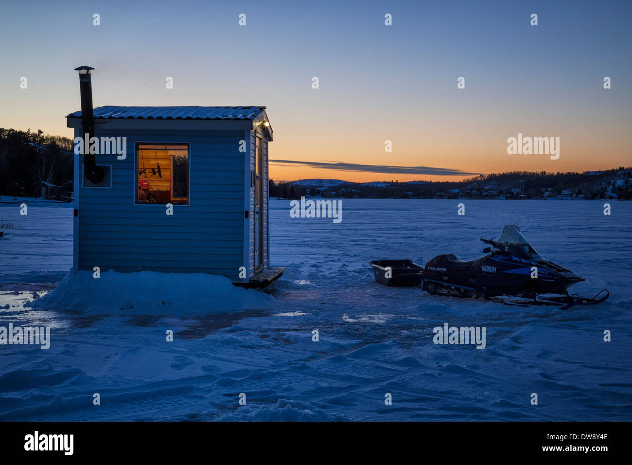 An ice-fishing hut on Long Lake, Sudbury, Ontario, Canada. - Stock Image