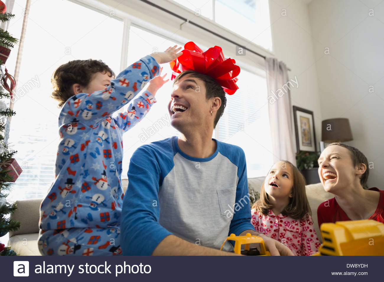 Playful family at home during Christmas - Stock Image