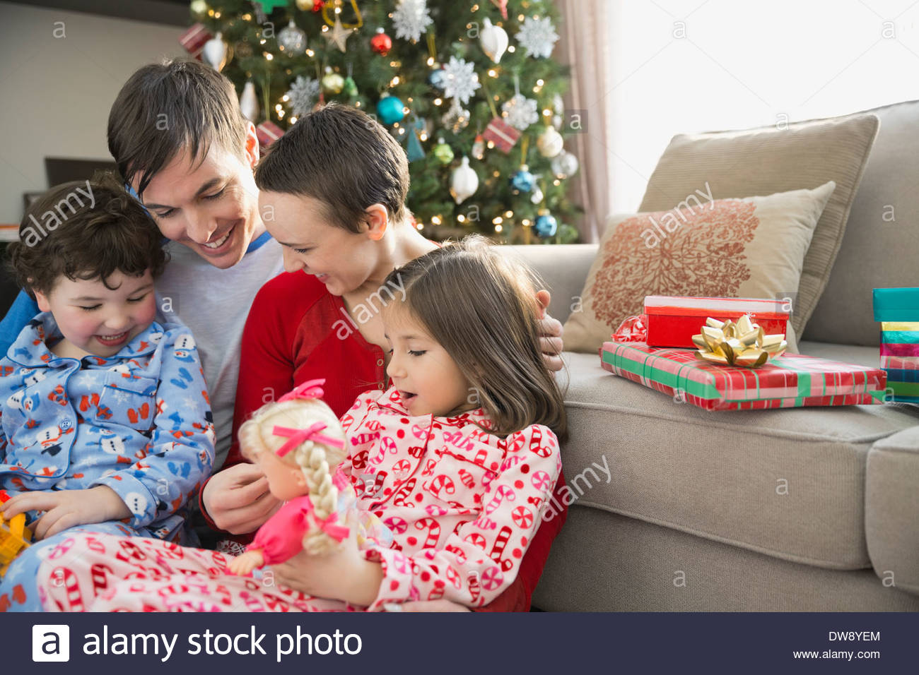 Family spending leisure time at home during Christmas - Stock Image