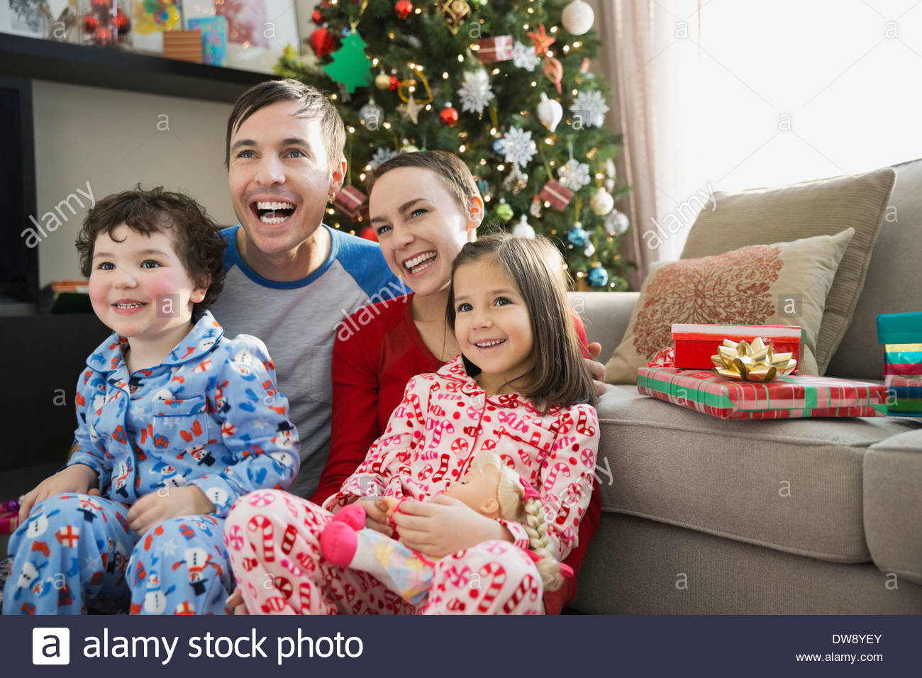 Cheerful family at home during Christmas Stock Photo