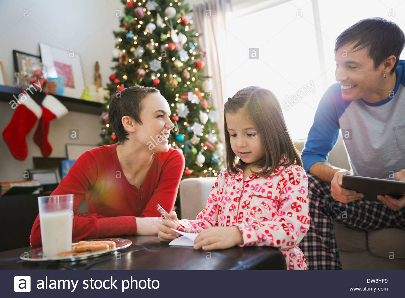 Girl writing letter to Santa Claus - Stock Image