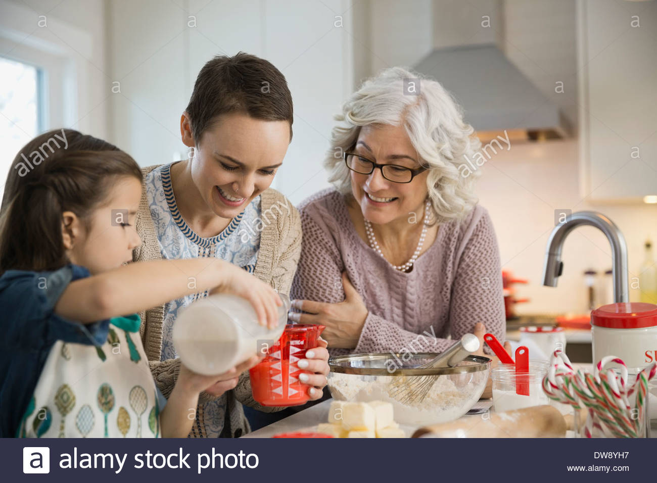 Three generation family baking cookies during Christmas Stock Photo
