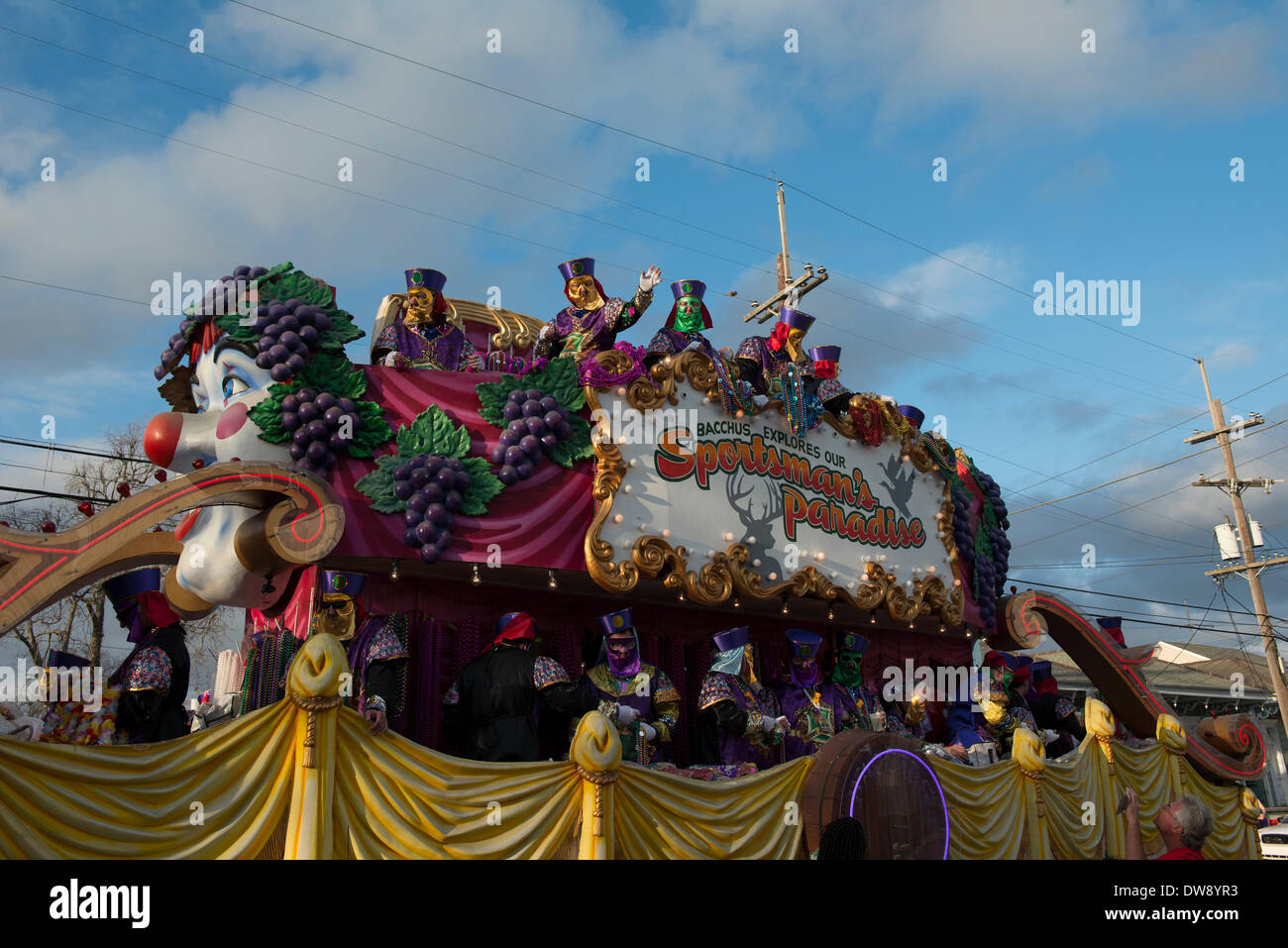 New Orleans, Louisiana, 2 March, 2014. The Krewe of Bacchus prepares to kick off the Mardi Sunday parade themed, Stock Photo