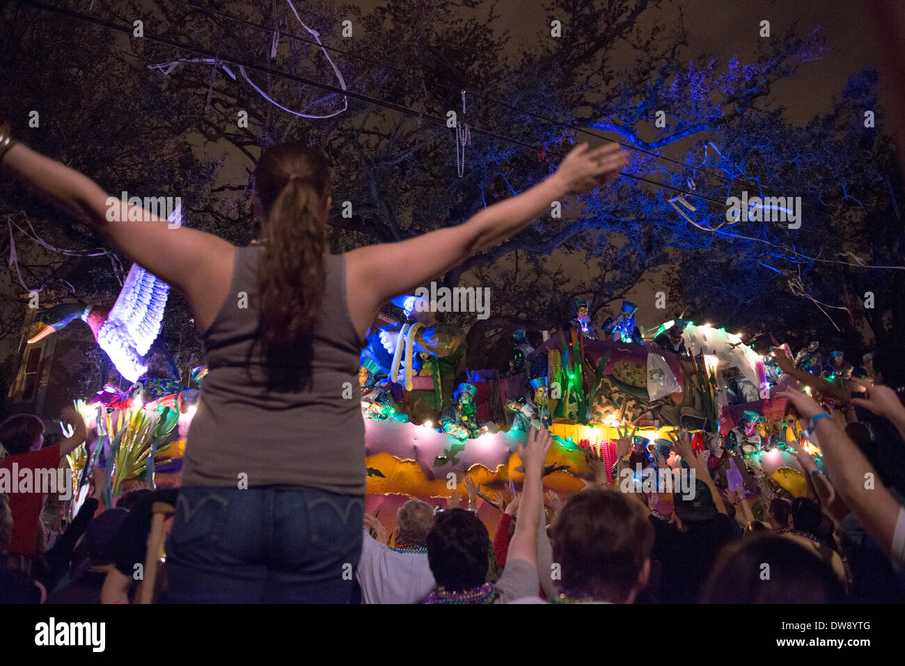 New Orleans, Louisiana, 2 March, 2014. Crowds flood  St. Charles Street to watch the Krewe of Bacchus parade, this Stock Photo