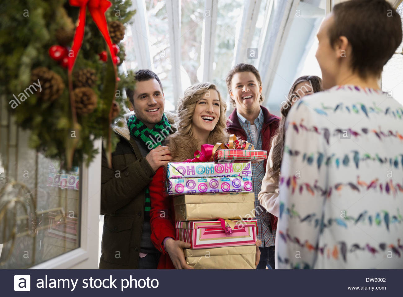 Guests arriving with Christmas gifts - Stock Image