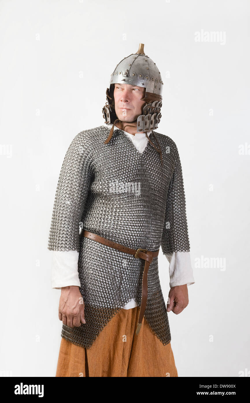 medieval warrior man wearing in ancient mail armor on white - Stock Image
