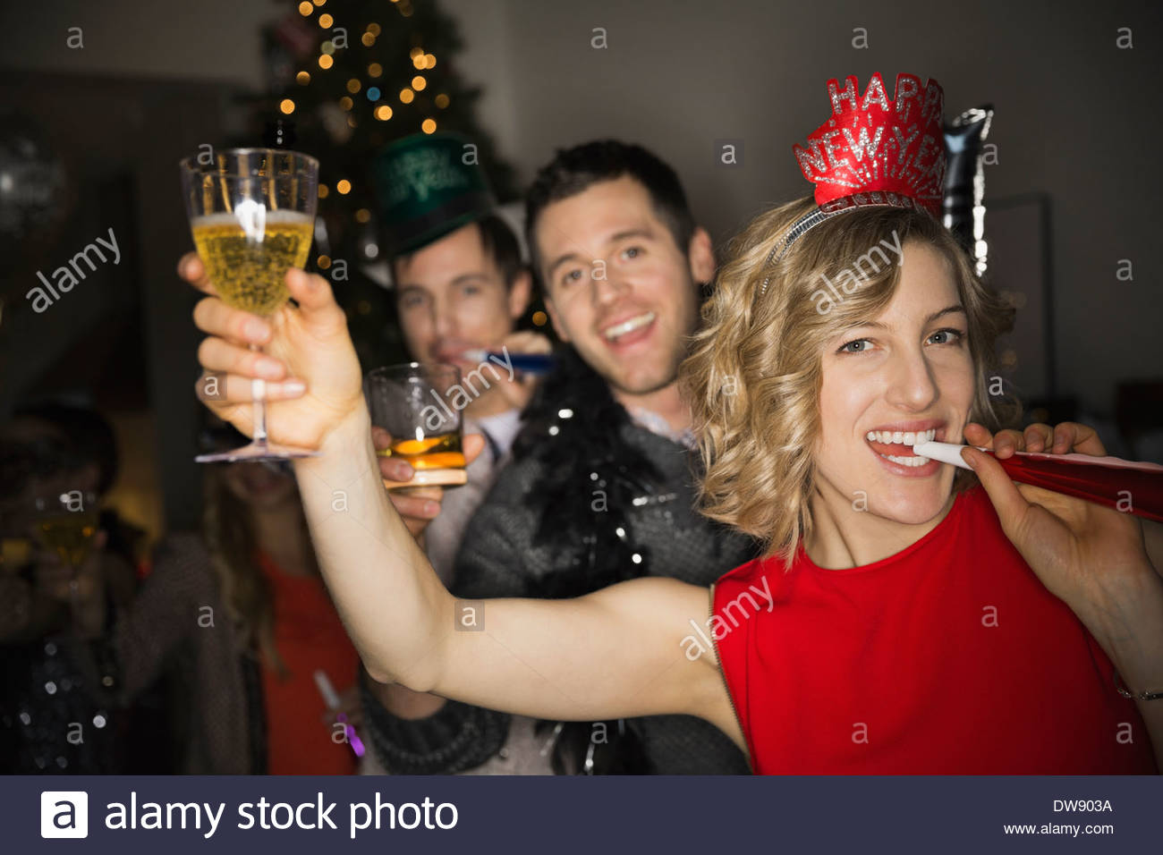 Portrait of friends enjoying New Years Eve party - Stock Image