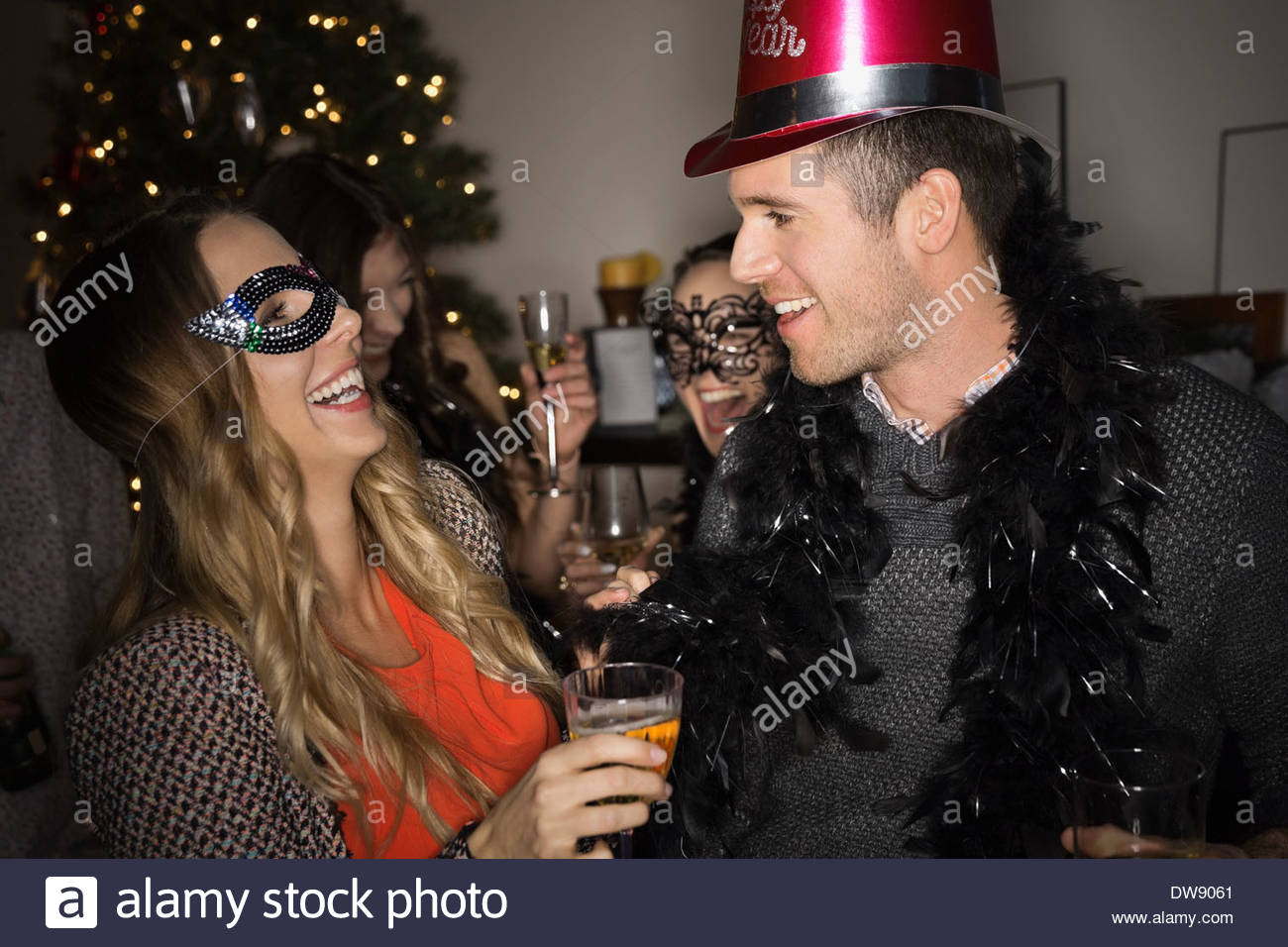 Couple enjoying New Years Eve party at home - Stock Image