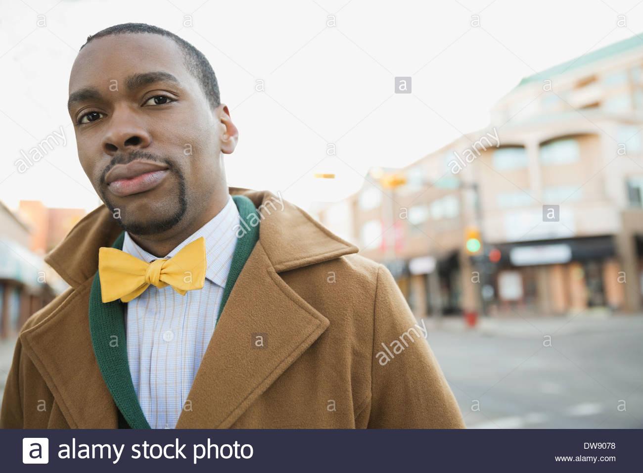 Portrait of confident man on city street - Stock Image
