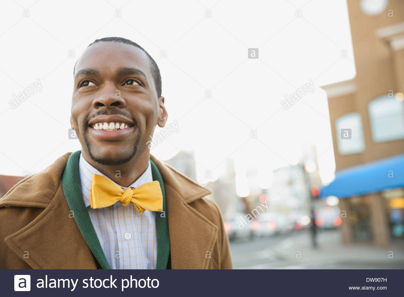 Smiling man outdoors wearing bow tie - Stock Image