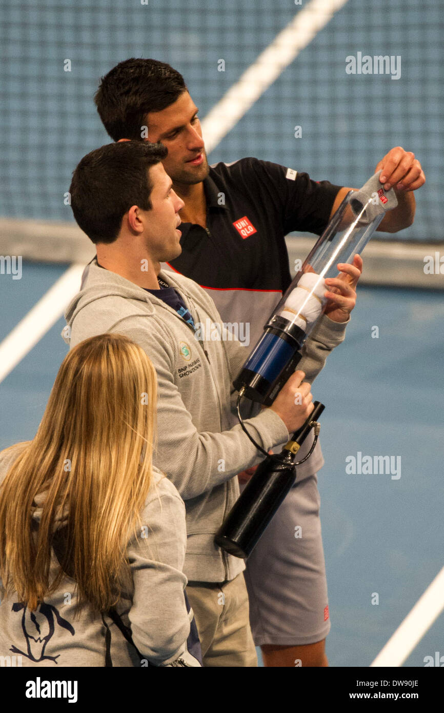 Manhattan, New York, USA. 3rd Mar, 2014. March 03, 2014: Novak Djokovic loads his sweat band into an air gun to be shot into the crowd during the BNP Paribas Showdown on World Tennis Day at Madison Square Garden in Manhattan, New York. Credit:  csm/Alamy Live News - Stock Image
