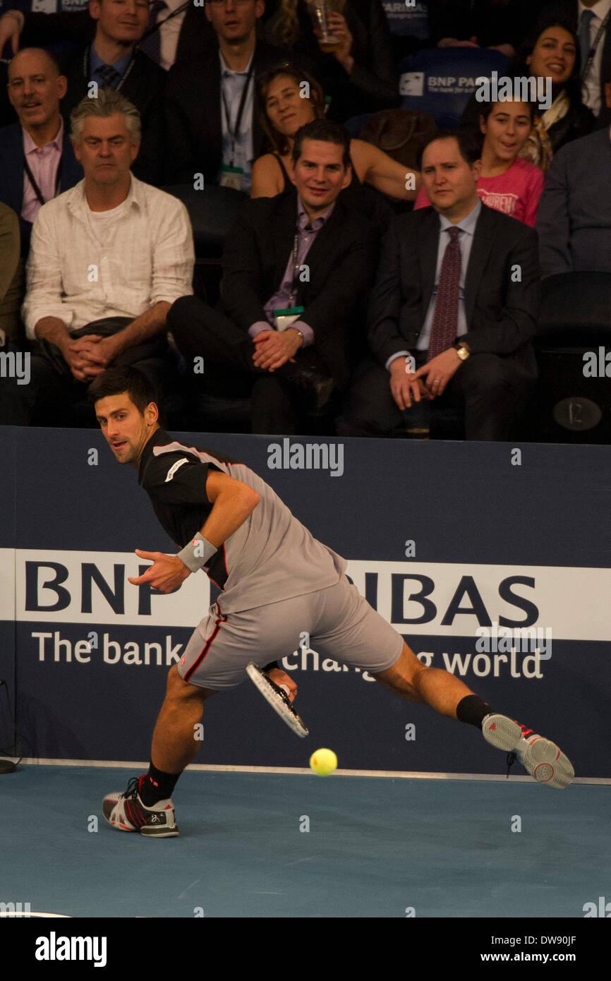 Manhattan, New York, USA. 3rd Mar, 2014. March 03, 2014: The crowd watches Novak Djokovic return the ball through his legs during the BNP Paribas Showdown on World Tennis Day at Madison Square Garden in Manhattan, New York. Credit:  csm/Alamy Live News - Stock Image