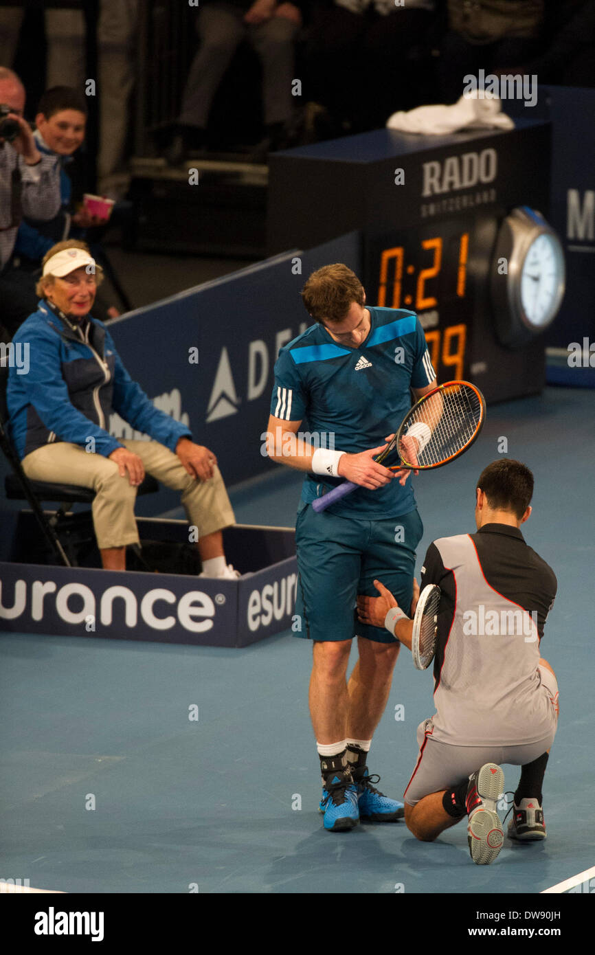Manhattan, New York, USA. 3rd Mar, 2014. March 03, 2014: Novak Djokovic rubs Andy Murray's leg as the two tennis stars have a laugh during the BNP Paribas Showdown on World Tennis Day at Madison Square Garden in Manhattan, New York. Credit:  csm/Alamy Live News - Stock Image