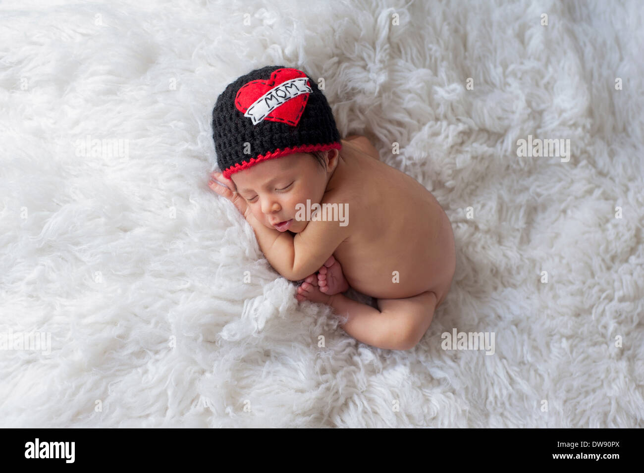 Sleeping baby boy wearing a