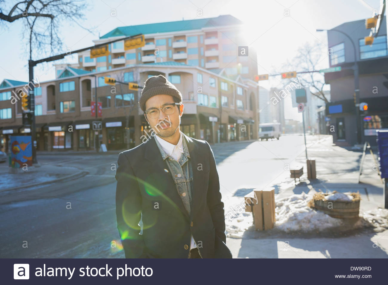 Portrait of confident man standing on city street - Stock Image