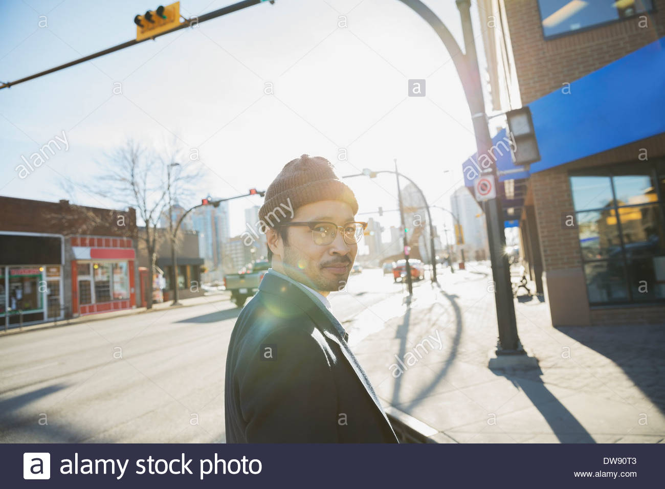 Side view portrait of man walking on city street - Stock Image