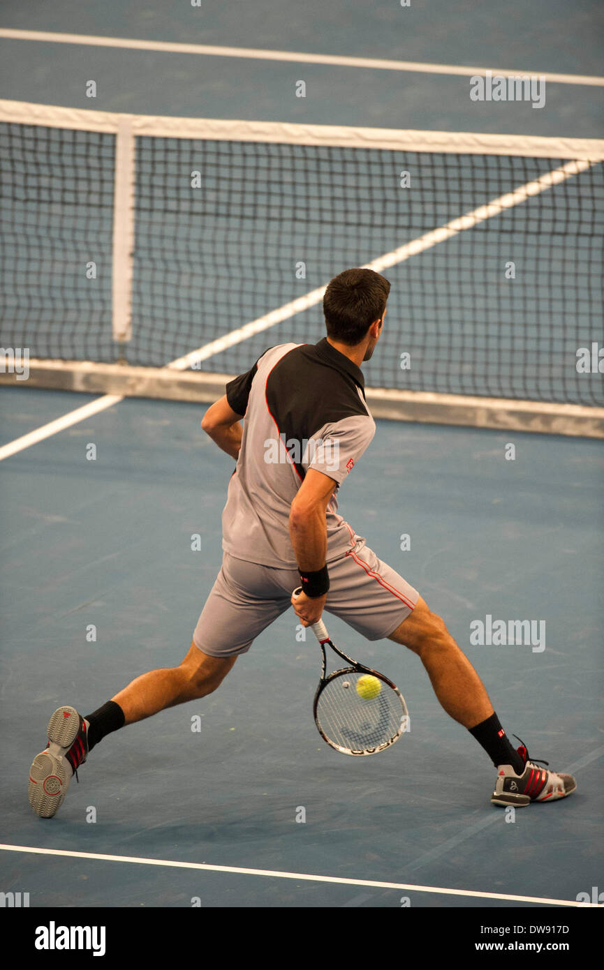 Manhattan, New York, USA. 3rd Mar, 2014. March 03, 2014: Novak Djokovic returns the ball by hitting it through his legs during the BNP Paribas Showdown on World Tennis Day at Madison Square Garden in Manhattan, New York. Credit:  csm/Alamy Live News - Stock Image