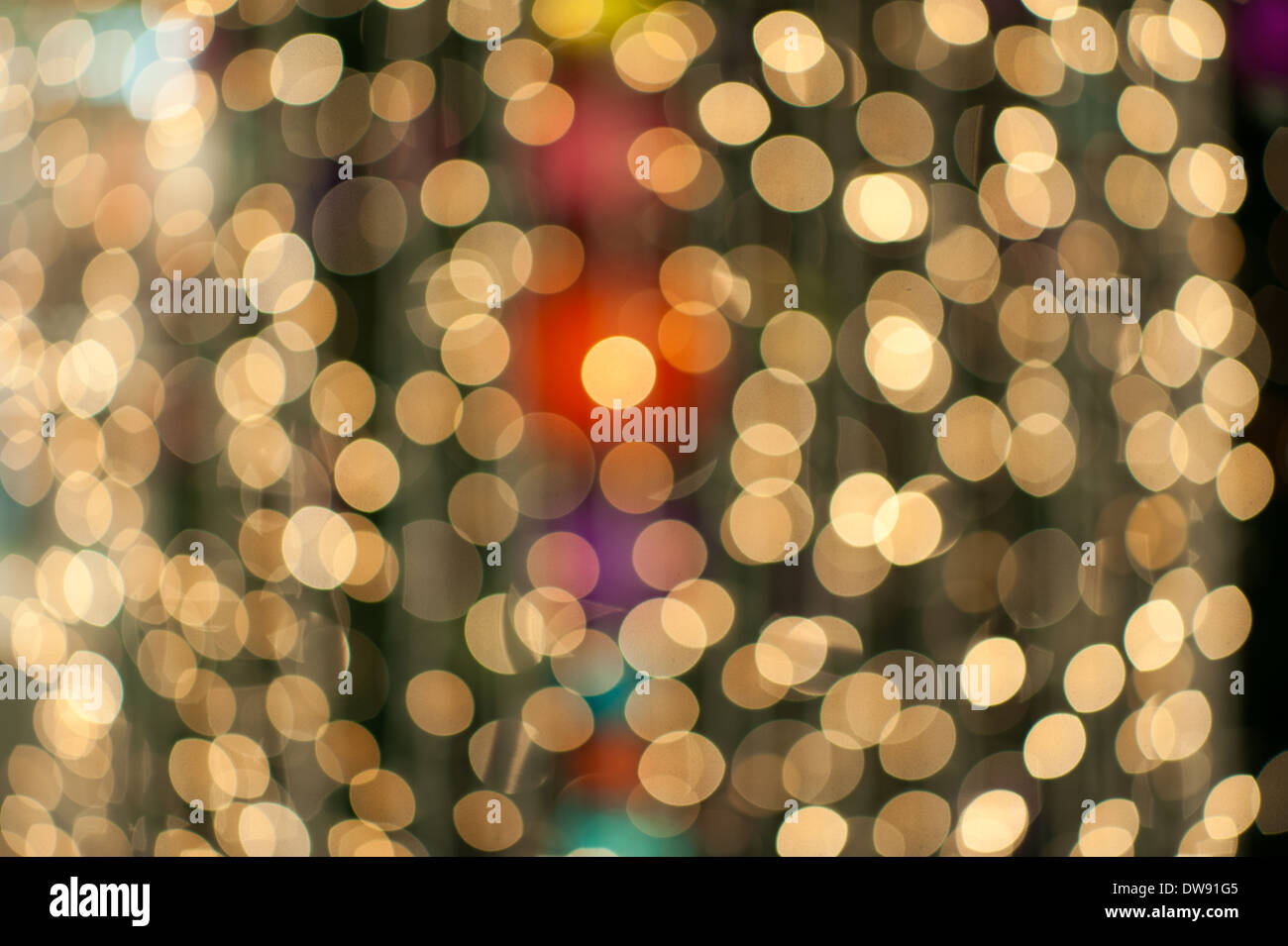 Abstract display of unfocused Christmas lights. - Stock Image