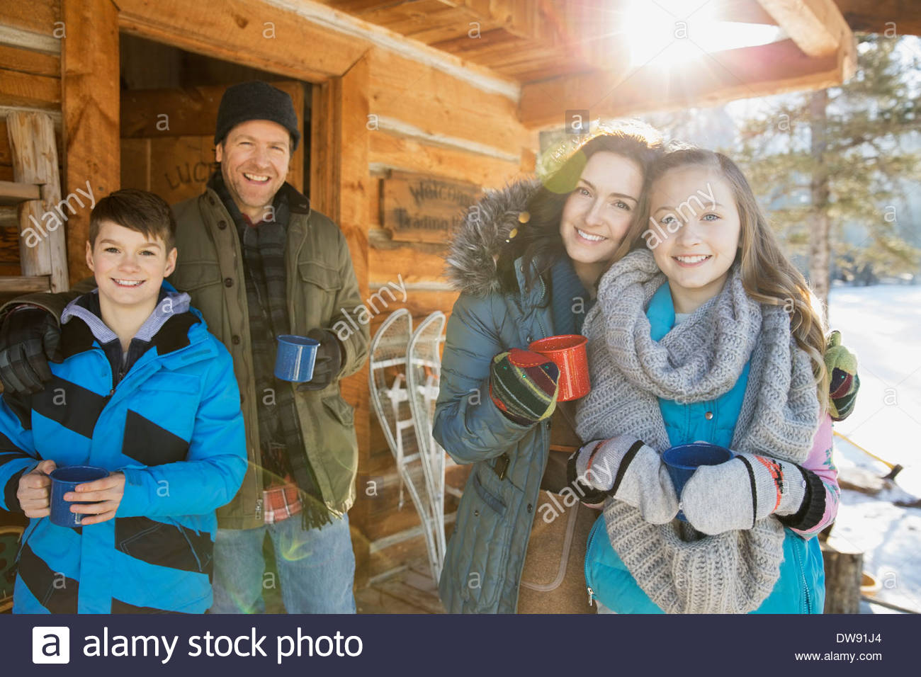 Portrait of family drinking hot chocolate outdoors - Stock Image
