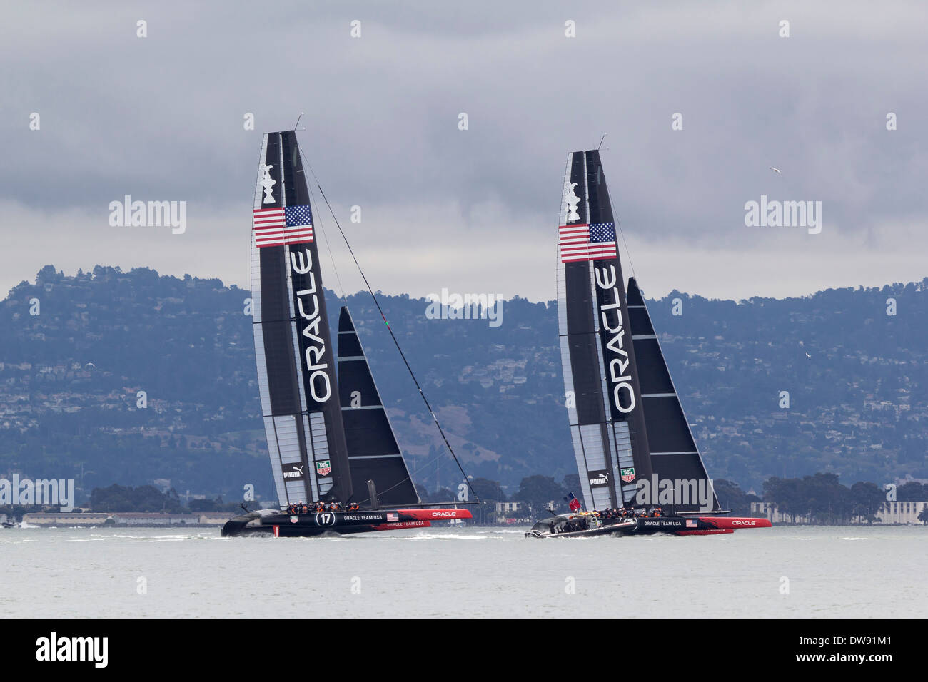 Catamarans for Oracle Team USA sail on San Francisco Bay during the 2013 Americas Cup competition. - Stock Image