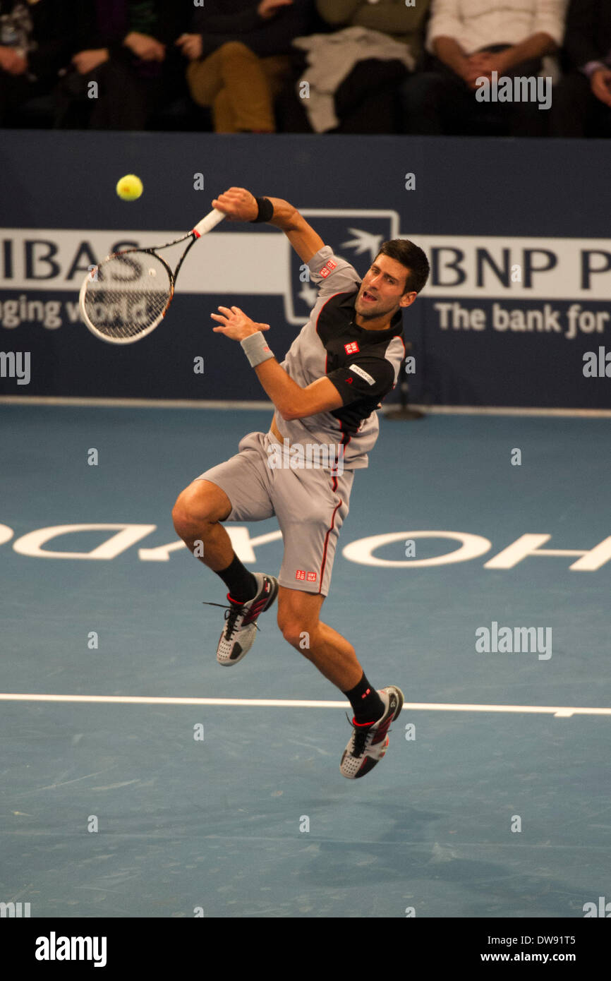 Manhattan, New York, USA. 3rd Mar, 2014. March 03, 2014: Novak Djokovic jumps to hit an overhead shot during The BNP Paribas Showdown on World Tennis Day at Madison Square Garden in Manhattan, New York. Credit:  csm/Alamy Live News - Stock Image