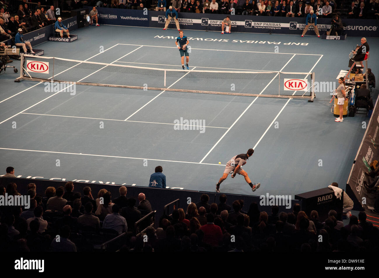 Manhattan, New York, USA. 3rd Mar, 2014. March 03, 2014: Novak Djokovic returns the ball through his legs to Andy Murray during The BNP Paribas Showdown on World Tennis Day at Madison Square Garden in Manhattan, New York. Credit:  csm/Alamy Live News - Stock Image