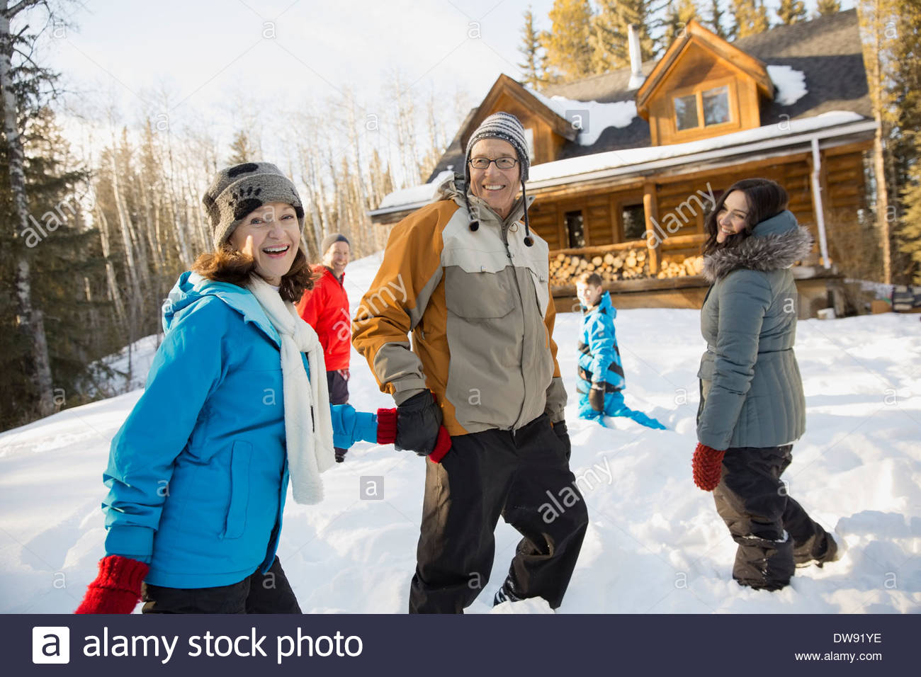 Senior couple walking in snow - Stock Image