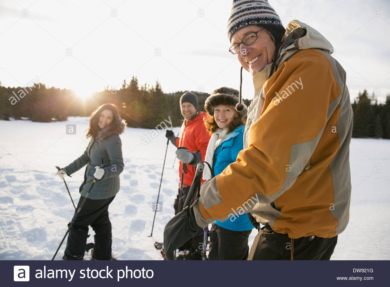 Portrait of multi-generation family snowshoeing - Stock Image
