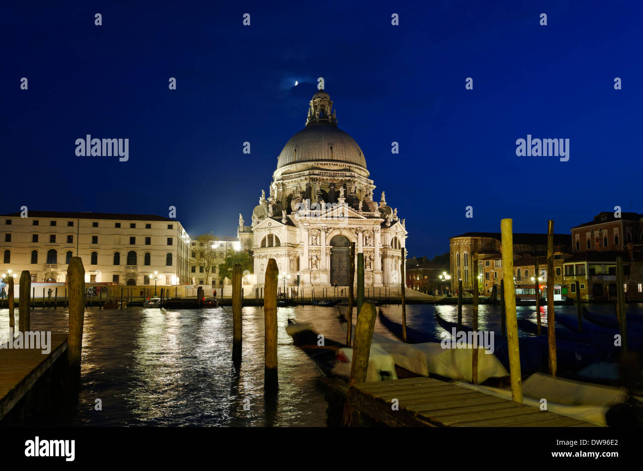 Grand Canal or Canal Grande with the Santa Maria della Salute church, from the Calle del Traghetto, at dusk, San Marco quarter - Stock Image