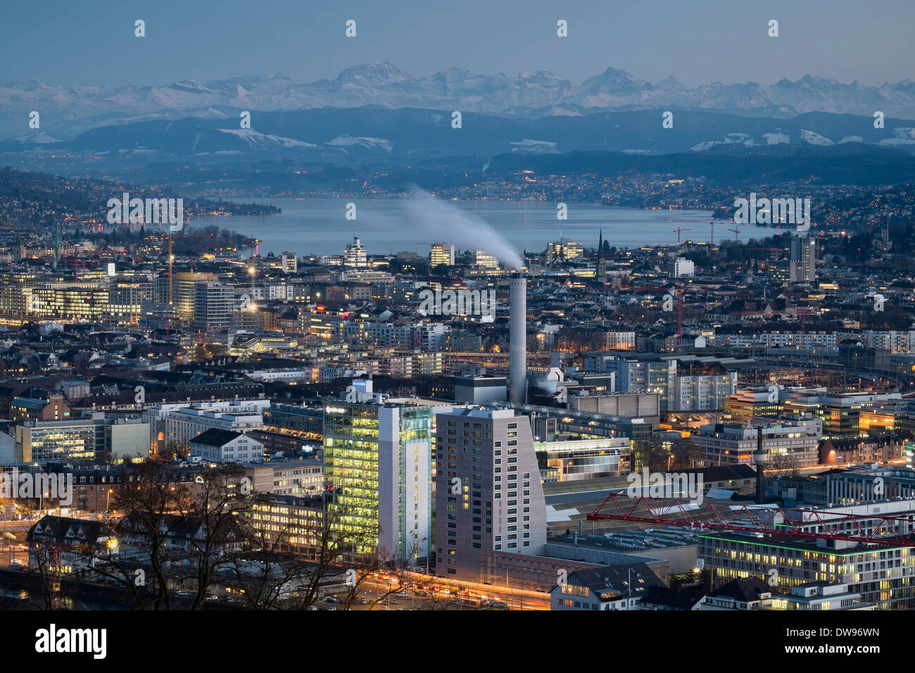 Cityscape, Lake Zurich at the rear, Swiss Alps on the horizon, Zurich, Switzerland - Stock Image
