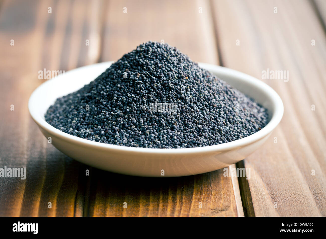 the poppy seed in bowl - Stock Image
