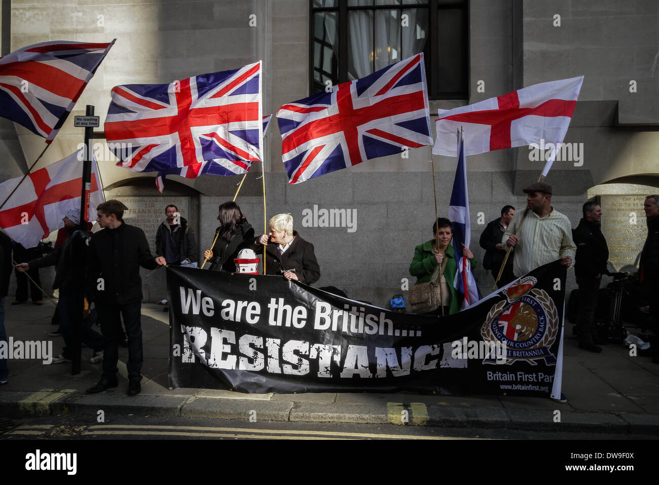 Members of Britain First right-wing patriot group demonstrate outside Old Bailey court in London. - Stock Image
